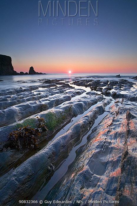 Bantham beach rock formations at sunset, Devon, England, UK, December 2005.