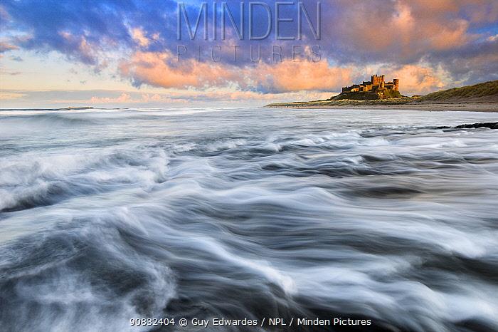 Long exposure of waves at Bamburgh Castle, Northumberland, England, UK. February 2019,