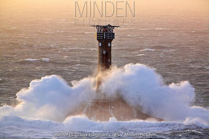 Waves crashing around Longships Lighthouse, Lands End, Cornwall, England, UK, January 2007.