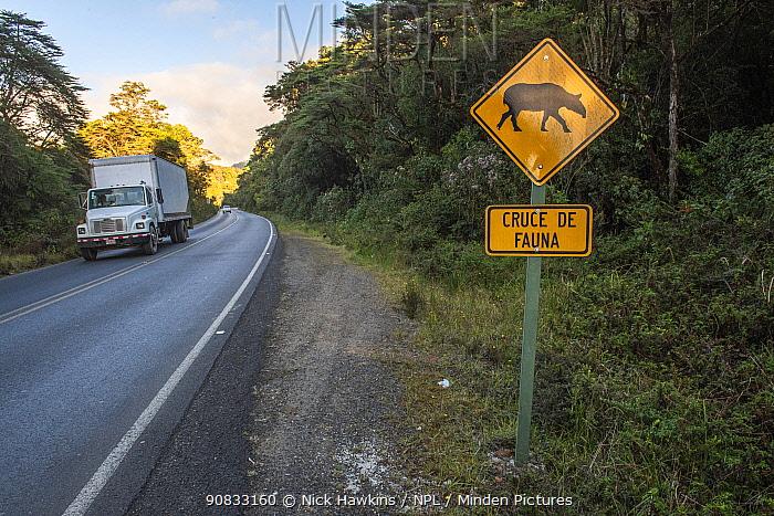 Wildlife road warning sign featuring a tapir along the Pan-American highway through the Talamanca Mountain range, Costa Rica.