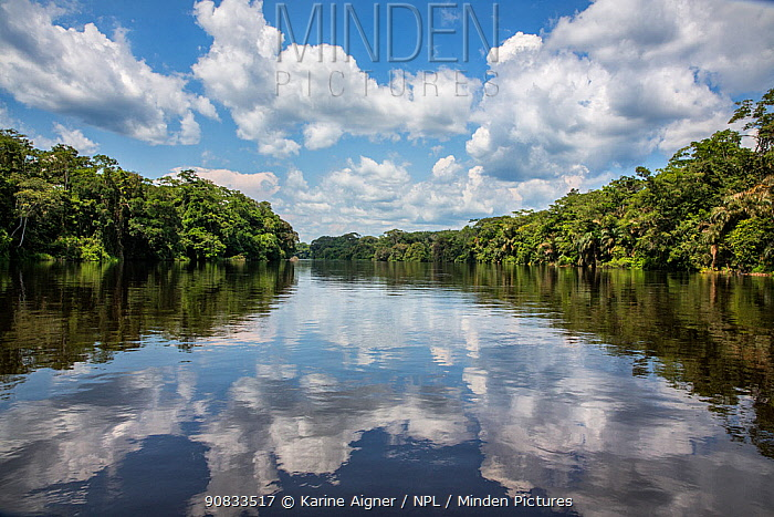 River landscape with clouds reflected in the surface of the water, Democratic Republic of the Congo.