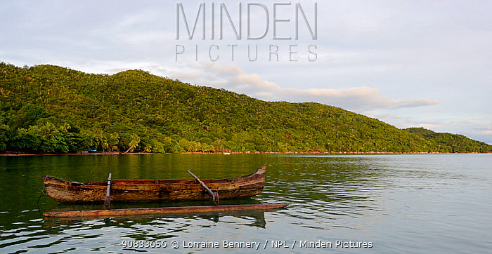 Outrigger canoe from the village of Ampasipoly, Lokobe mountain, at high tide. Madagascar.