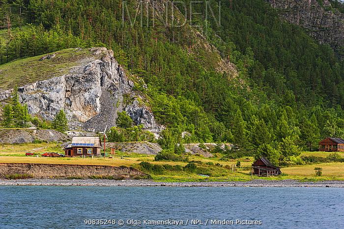 Small house with wind turbine, on the shore of Lake Baikal, East Olkhon. Lake Baikal, Siberia, Russia. July 2015.