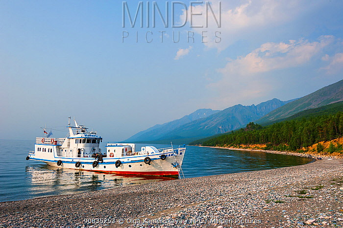 Boat moored on the lake shore of Lake Baikal, Siberia, Russia. July 2015