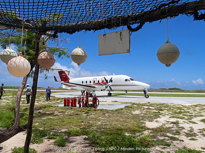 Beechcraft 1900 aircraft arriving to pick up passengers on Astove Atoll, Seychelles, November 2019.