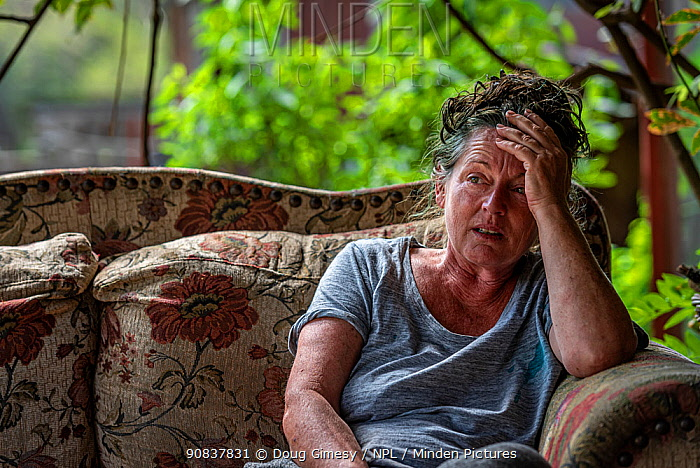 Sharon Small, one of the founders of Goongerah Wombat Orphanage, sitting at home after the 2019/20 bushfires devastated the area. Sharon's house was spared, but she lamented the loss of her surrounding home. Goongerah, Victoria, Australia,?February , 2020?. Editorial use only.
