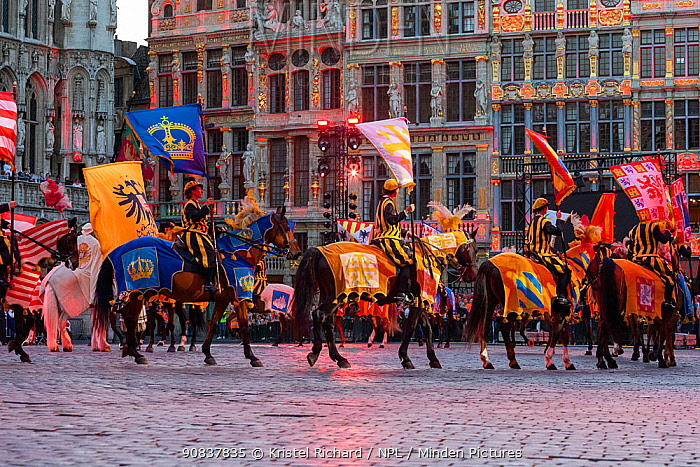Costumed horses and riders in Ommegang religious and historical pageant procession. Grand-Place, Brussels, Begium. June 2019.