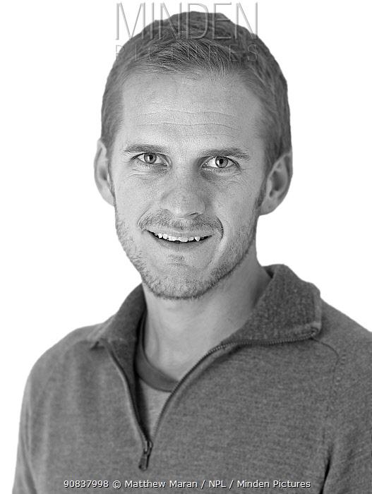 Black and white portrait of photographer Matt Maran on white backgruond.