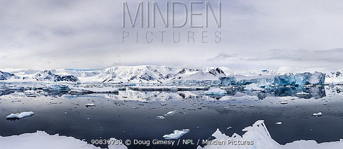 View across Southern Ocean to coastline, panorama. Wilhelmina Bay, Antarctic Peninsula, Antarctica. December 2019. Digitally stitched image.