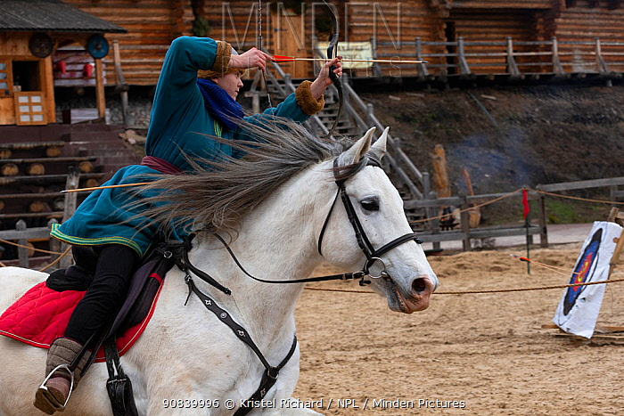 Archer mounted on Spanish horse, aiming arrow at target. Kievan Rus Park, a reconstruction of the former capital Rus. Ukraine, 2020.