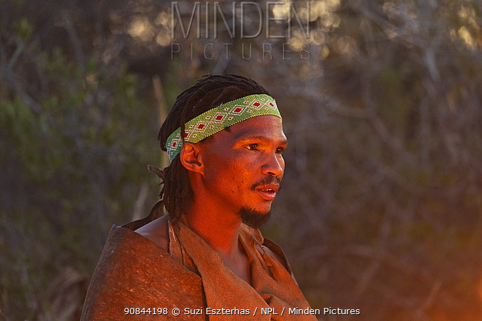 San bushman, portrait in glow of fire. Makgadikgadi Pans National Park, Botswana. 2019.