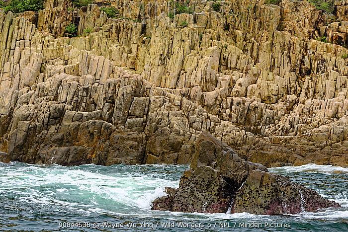 Cliffs with crashing waves in Hong Kong Global Geopark, China, June 2016.