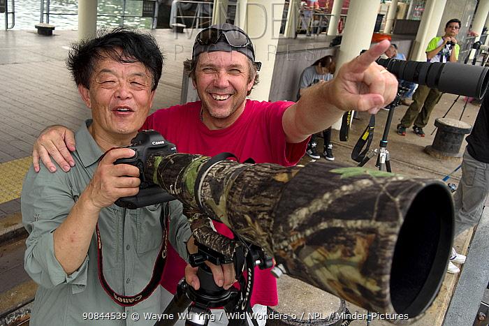 Photographer Chen Jianwei and Magnus Lundgren working side by side, Sai Kung Pier, Hong Kong, China, June.