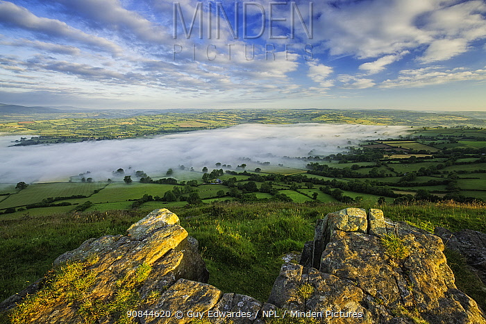 Morning mist over Llangors and Llangors Lake, view from Mynydd Llangorse, Brecon Beacons National Park, Wales, UK. June 2014.