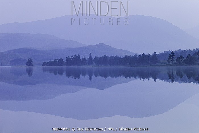 Hills and trees reflected in Loch Tulla, Argyll and Bute, Scotland, UK. September 2005.