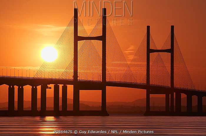 Second Severn Crossing suspension bridge over River Severn between England and Wales, at sunset. Gloucestershire, England, UK. September 2006.