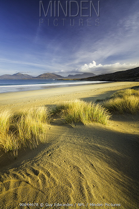Sand dunes at Luskentyre, mountains across sea. Isle of Harris, Outer Hebrides, Scotland, UK. March 2014.