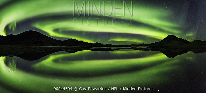 Aurora Borealis reflected in Kylingavotn lake, Landmannalaugar, Iceland. September 2015.