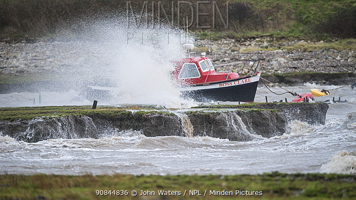 Small boats tossed in their moorings by Storm Jorge as it batters Clevedon harbour, Severn Estuary near Bristol, UK. March 2020.