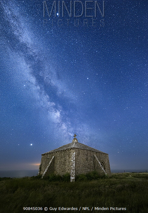 St Aldhelm's Chapel at night with the Milky Way, St Aldhelm's Head, Isle of Purbeck, Dorset, England, UK, June 2020.