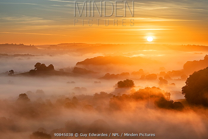 Sunrise over the Blackmore Vale from Cadbury Castle, South Cadbury, Somerset, England, UK, May 2020.