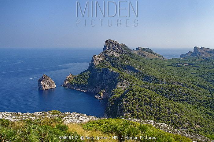 Cap de Formentor, limestone headland, cliffs and El Colomer Islet in morning light, north east Mallorca, August 2018.