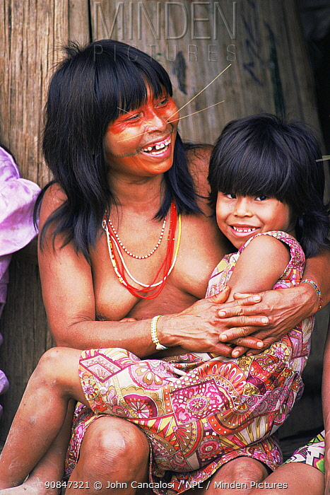 Mayoruna Indian woman with fake whiskers simulating jaguar, Peru, South America. This tribe practice traditional tattoos and they have whiskers as they believe they are descendants of jaguar and revere their strength.