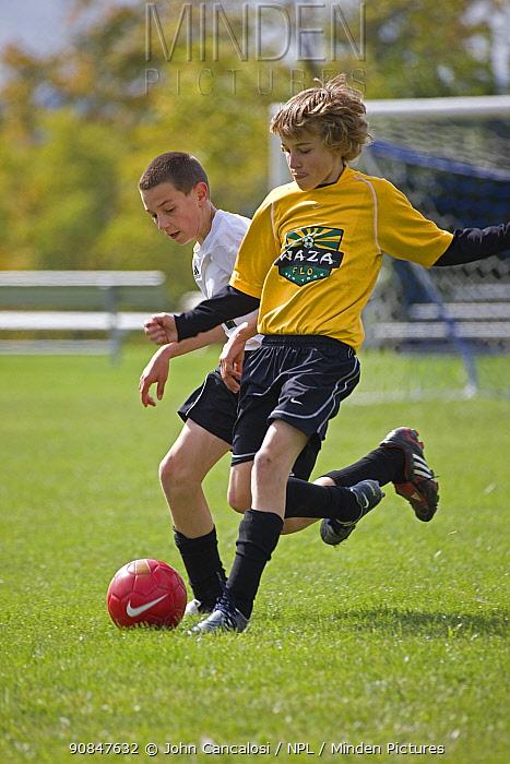 Two boys playing football, USA