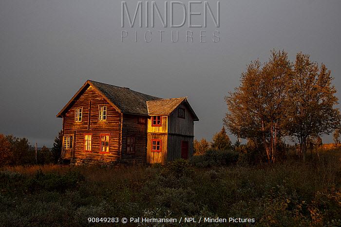 Old wooden mountain farmhouse in morning light. Golsfjell, Buskerud, Viken, Norway. September 2019.