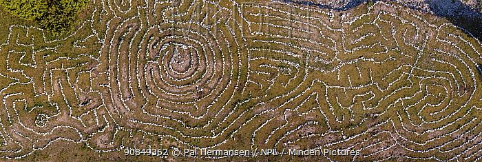 Labyrinth made from stones, aerial view. Holmhallar, South Gotland, Sweden. August 2018.