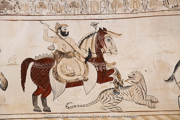 Mural painting of rider on horse with a spear and a tiger, Laxminarayan Temple, Madhya Pradesh, India.