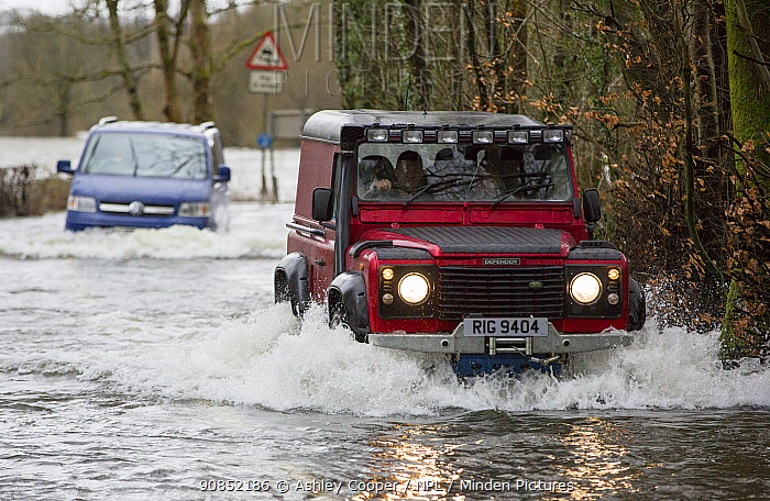 Land Rover driving through flood caused by Storm Ciara. Rothay Bridge, Ambleside, Lake District, UK. February 2020.
