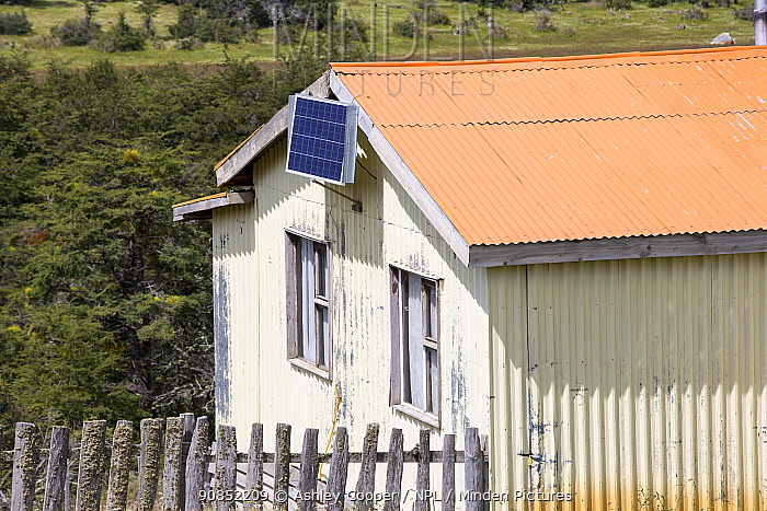 Photovoltaic panel on side of house. Near Puerto Natales, Magallanes, Chile. January 2020.