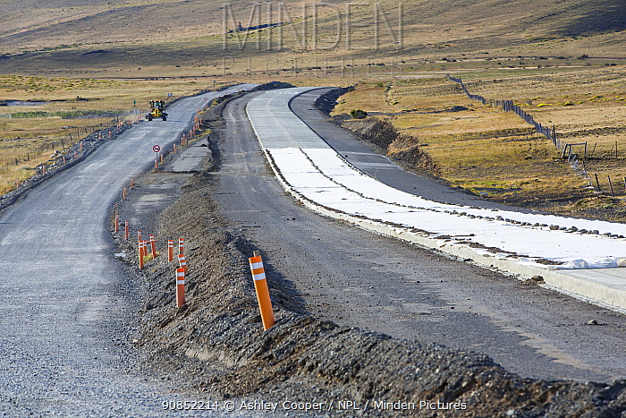 Road building in steppe between Cerro Castillo and Torres del Paine National Park to cope with increased tourism, concrete replacing gravel road. Patagonia, Chile. January 2020.