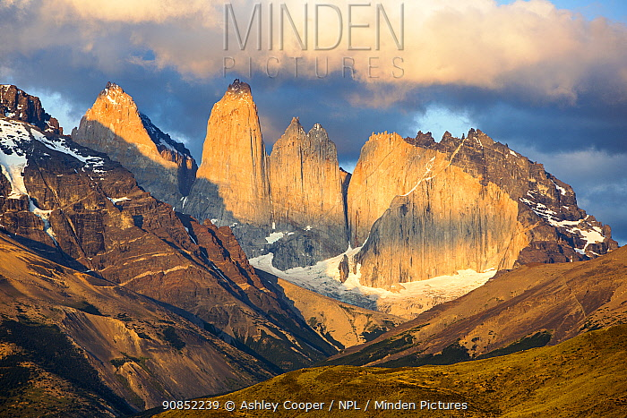 Torres del Paine rock towers and adjacent mountains at sunrise. Torres del Paine National Park, Patagonia, Chile. January 2020.