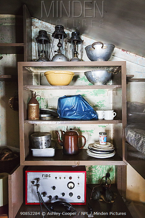 Radio, kitchen crockery and colanders on shelf in Wordie House, a former British scientific research base. Winter Island, Argentine Islands, Antarctica. 2020.