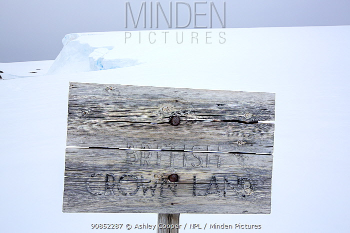 Fading wooden sign reading 'British Crown Land' outside Wordie House, a former British scientific research base. Winter Island, Argentine Islands, Antarctica. January 2020.
