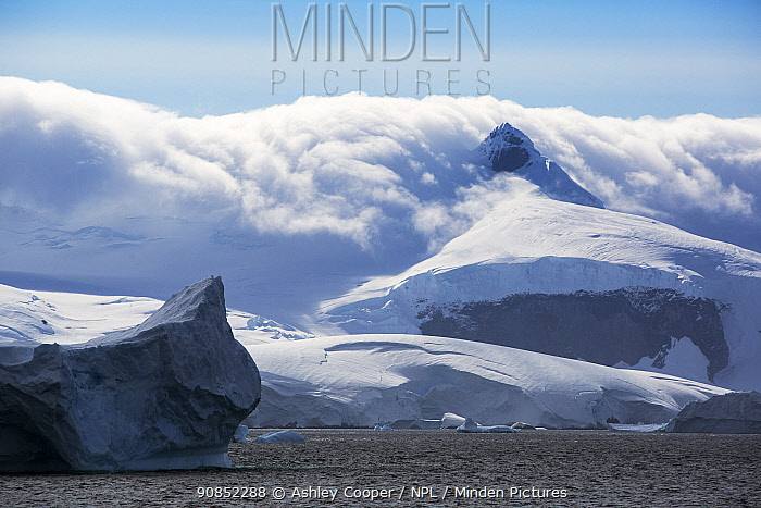 Snow covered mountains at edge of Lallemand Fjord, until recently large parts of the fjord were covered by the Muller ice shelf which collapsed due to climate change. Crystal Sound, Antarctic Peninsula, Antarctica. January 2020.