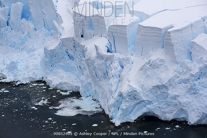Retreating glacier at coast. Temperatures on the Antarctic Peninsula have risen by three degrees centigrade in last 100 years. Palava Point, Two Hummock Island, Palmer Archipelago, Antarctica. December 2019.