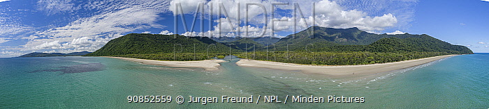 Coastline and mouth of Daintree River with rainforest and mountains inland, aerial view from Pacific Ocean. Wet Tropics of Queensland, Near Cape Tribulation, Australia. 2017.