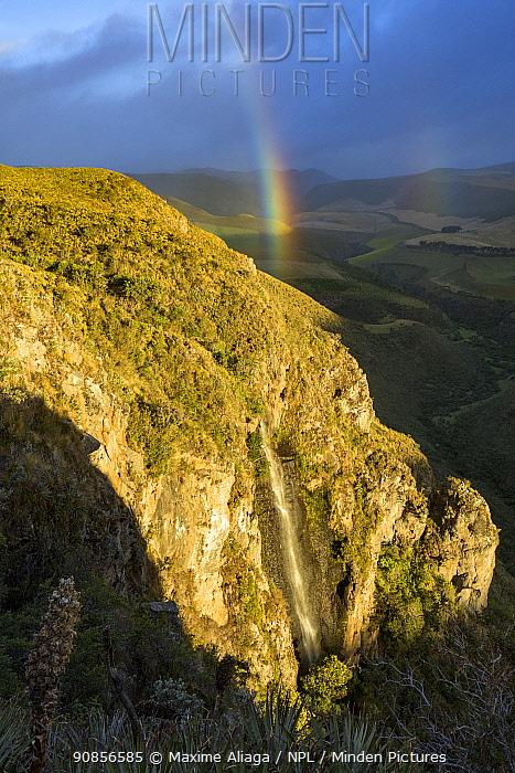 Rainbow over Paramo ecosystem - with Antisanilla reserve, Antisana Volcano, Ecuador.