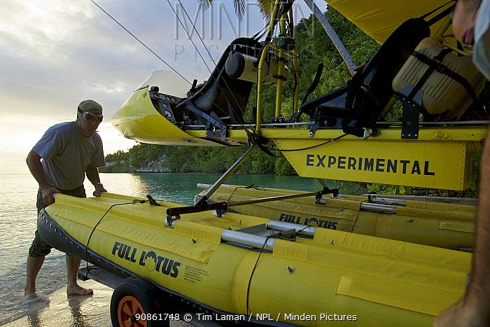 Pilot Max Ammer with his ultralight float plane. Kri Island, Raja Ampat Islands, Indonesia.
