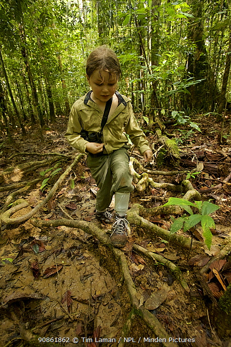 Young girl Jessica Laman hiking in Cabang Panti Research Station, Gunung Palung National Park, Borneo. Model released