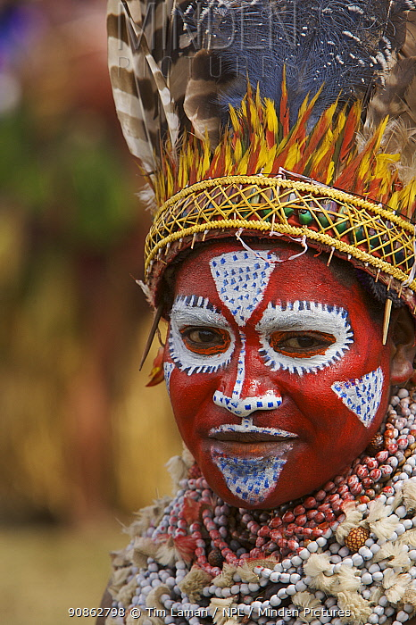 Woman in traditional feathered headdress with painted face, Mount Hagen, Western Highlands Province, Papua New Guinea. September 2004