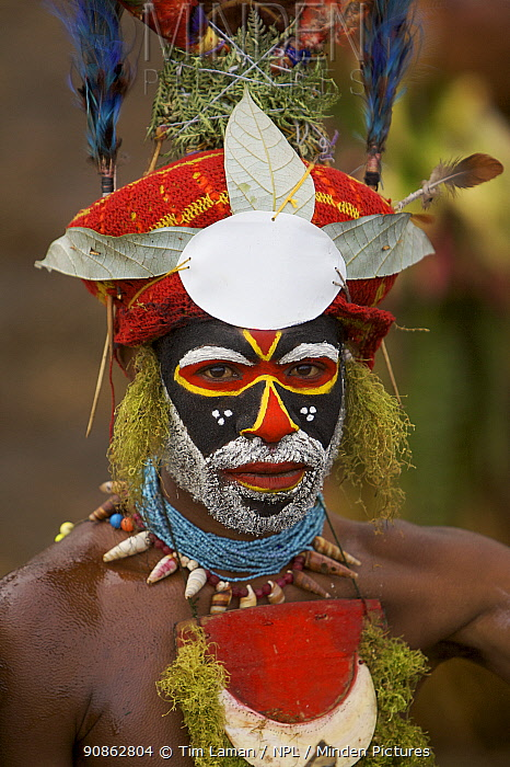 Man in traditional costume with painted face , Mount Hagen, Western Highlands Province, Papua New Guinea. September 2004