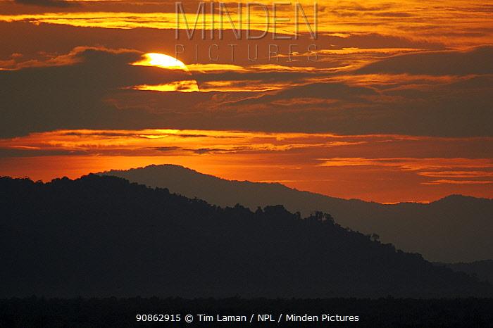 Sunset over the rainforest covered hills of East Sepik Province, Karawari River vicinity, East Sepik Province, Papua New Guinea, August 2005