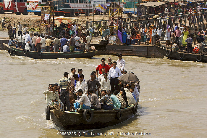 A passenger ferry / shuttle taking people across the Rupsha river at Khulna, Khulna Province, Bangladesh. March 2006