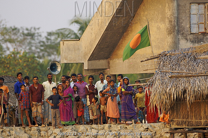 Villagers from Nolian Village watching our boat and waving to us, Khulna Province, Bangladesh, March 2006