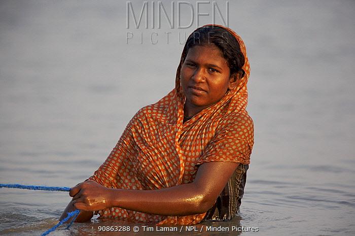 Woman pulling shrimp fry collecting nets along the shallows of the Kholpatura River, Gabura Village, Sundarbans, Khulna Province, Bangladesh, April 2006