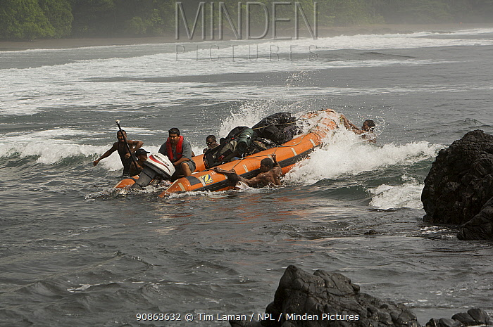 Zodiac boat landing research equipment and people through the surf at Moraka Playa base camp on the South coast of Bioko Island, Equatorial Guinea, Rapid Assessment Visual Expedition, International League of Conservation Photographers, January 2008. Model released